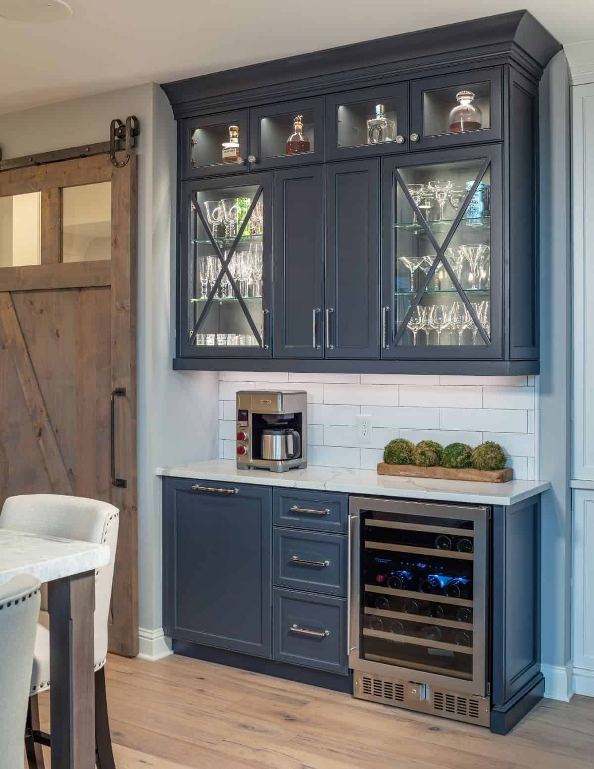 Bar with blue cabinets and barn door in Snapper Creek