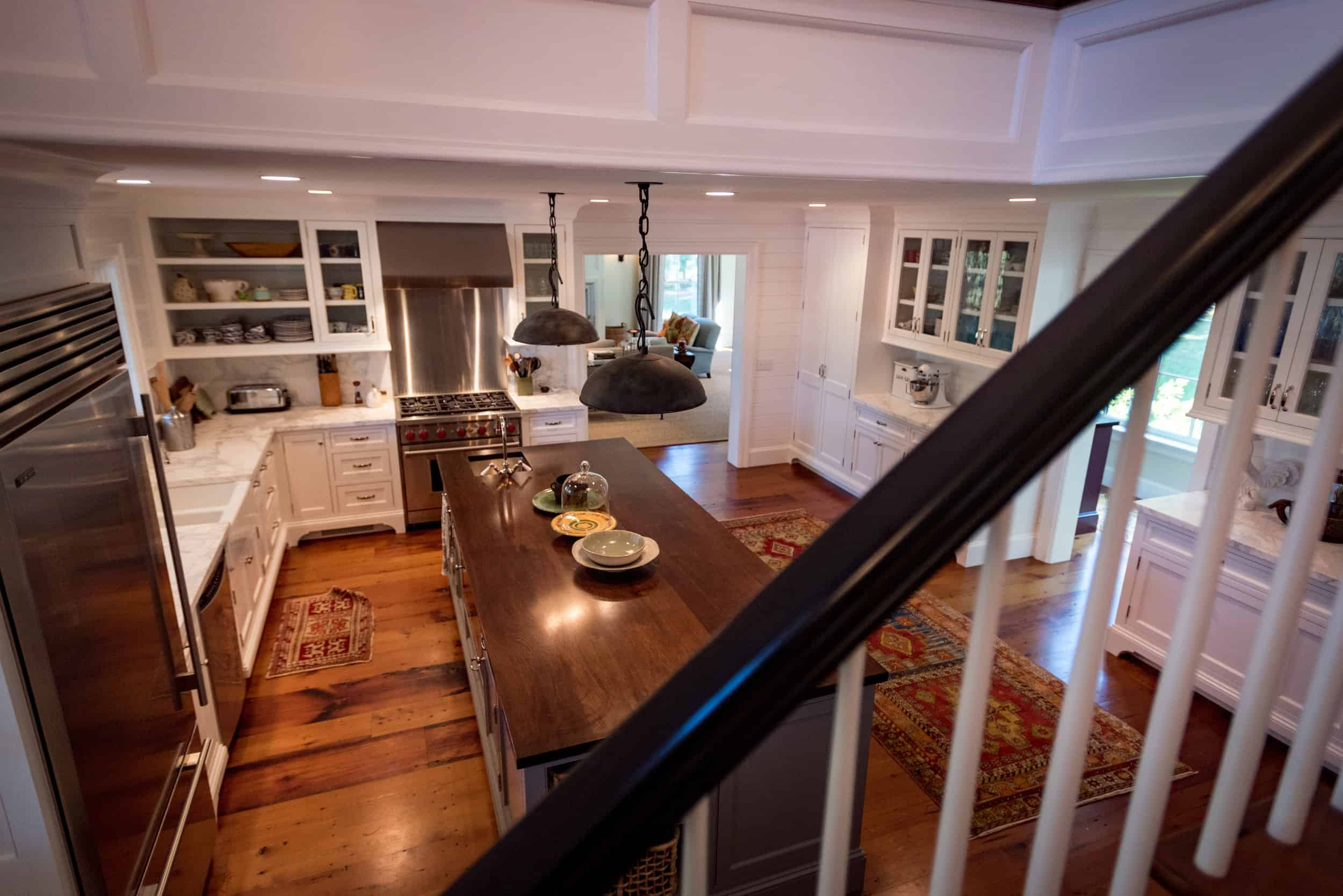 Large island with wood countertop in Snapper Creek