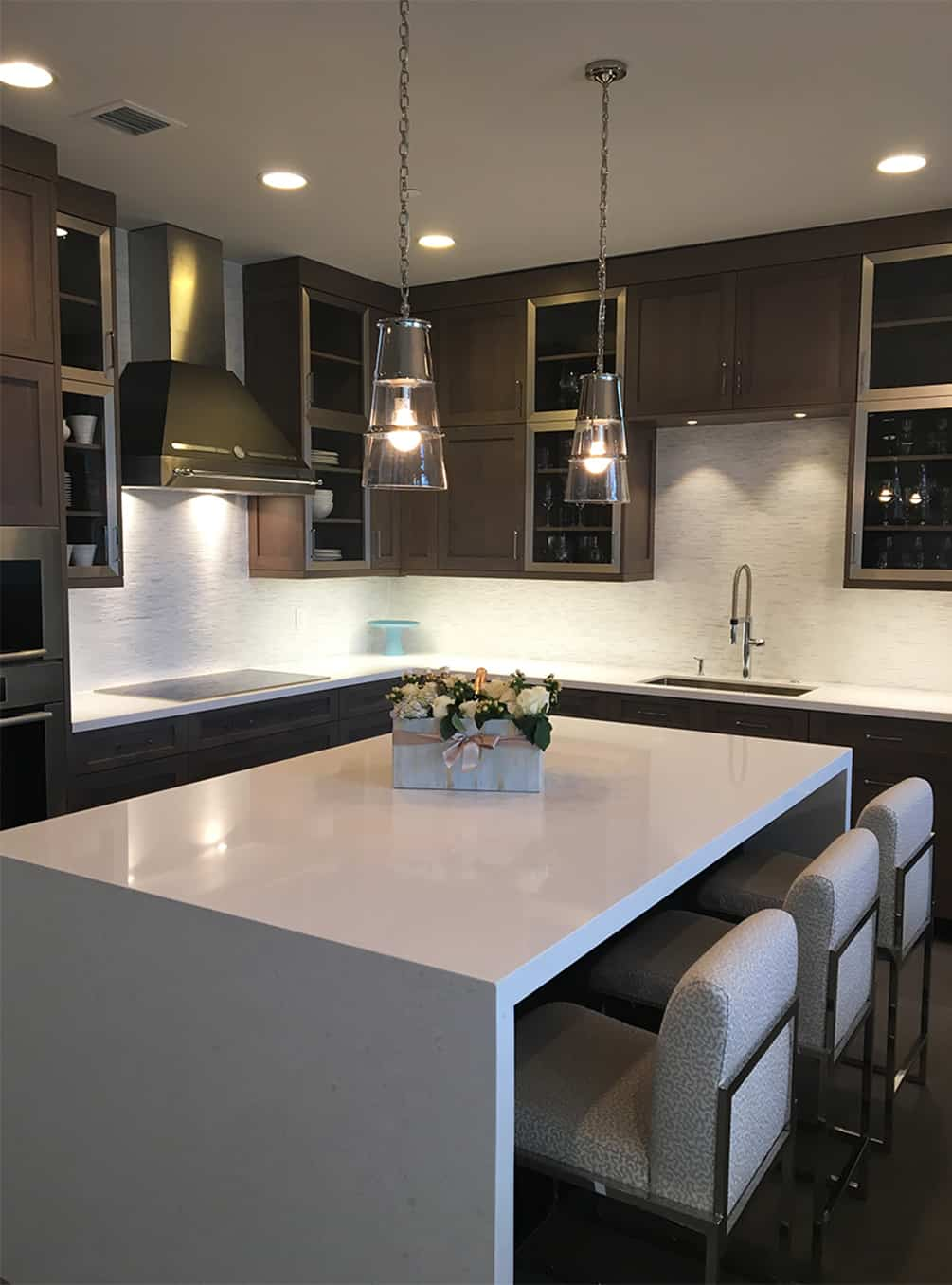 dark-cabinet-kitchen-with-quartz-counters