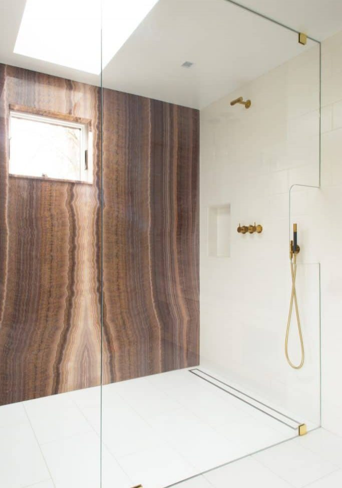 Curbless shower with gold fixture remodel in Palmetto Bay