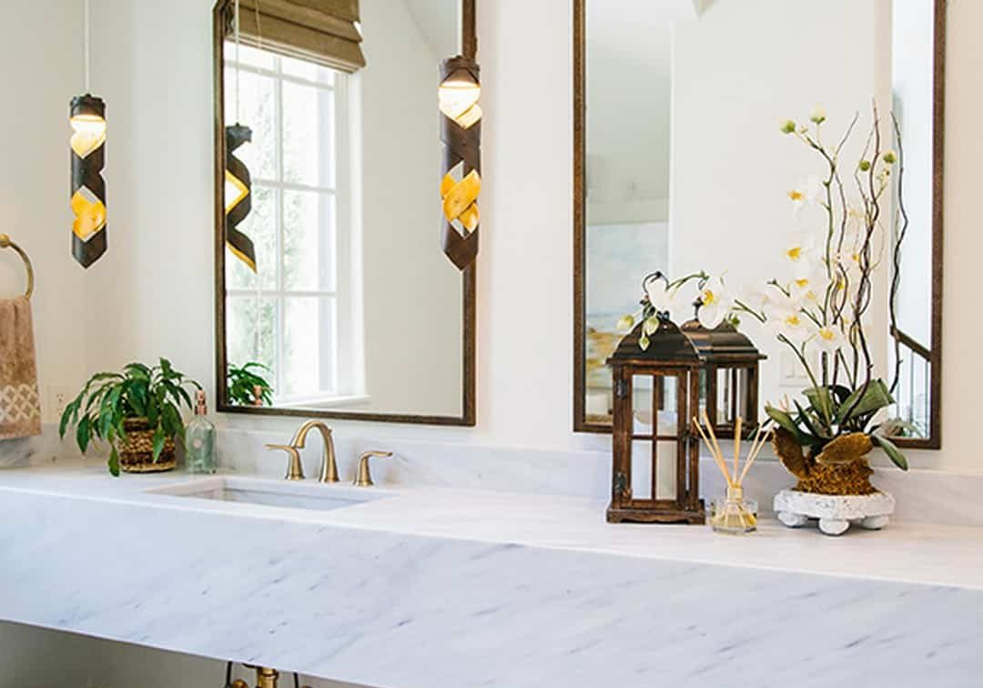 Farmhouse bathroom remodel with gold fixtures and floating sink in South Miami