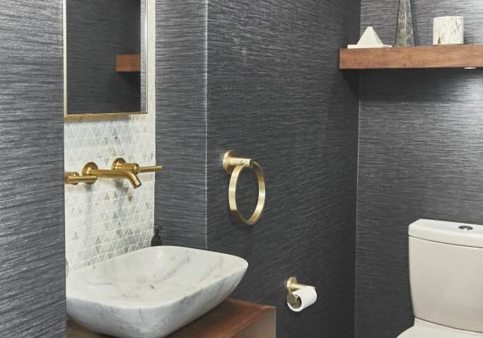 Wallpaper powder bath with sink and gold fixtures in South Miami